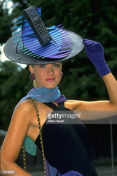 Portrait of a racegoer modelling a typically novel hat on Ladies Day during Royal Ascot at Ascot racecourse in Berkshire, England. \ Mandatory...