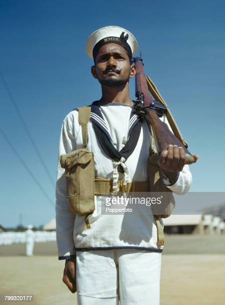 Portrait of a rating of the Royal Indian Navy pictured standing to attention holding a Short Magazine LeeEnfield rifle in February 1945