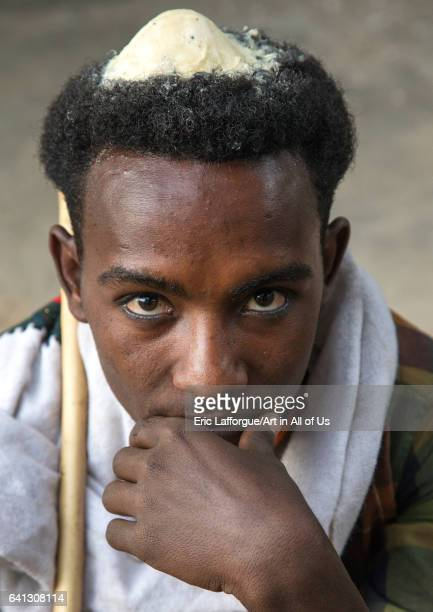 Portrait of a Raya tribe man with butter on his head to show he is on honeymoon on January 21 2017 in Gobiye Ethiopia