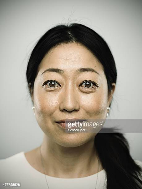Portrait of a real adult japanese woman looking at camera