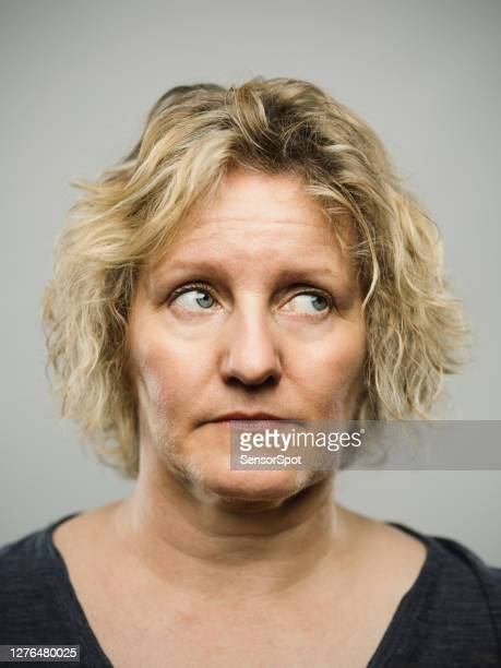 portrait of a real caucasian adult woman with blank expression looking to the side - eye stock pictures, royalty-free photos & images