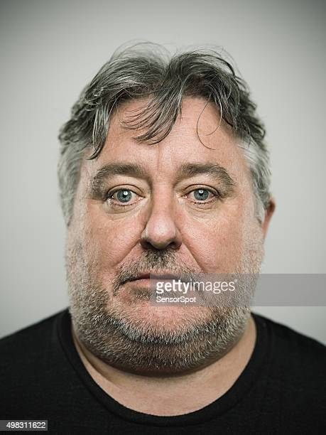 portrait of a real english man looking at camera. - police mugshot stock pictures, royalty-free photos & images