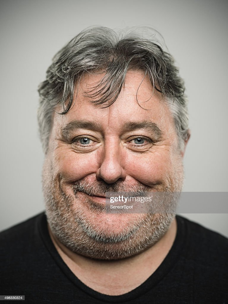 Portrait of a real happy english man looking at camera. : Stock Photo