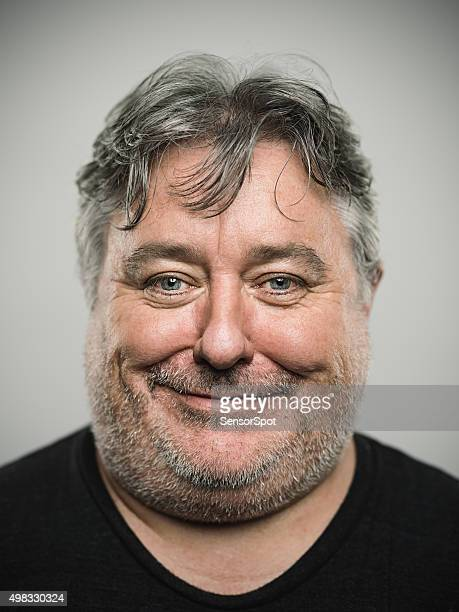 portrait of a real happy english man looking at camera. - chubby men stock photos and pictures