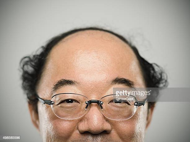 portrait of a real happy japanese man with black hair. - fat bald men stock pictures, royalty-free photos & images