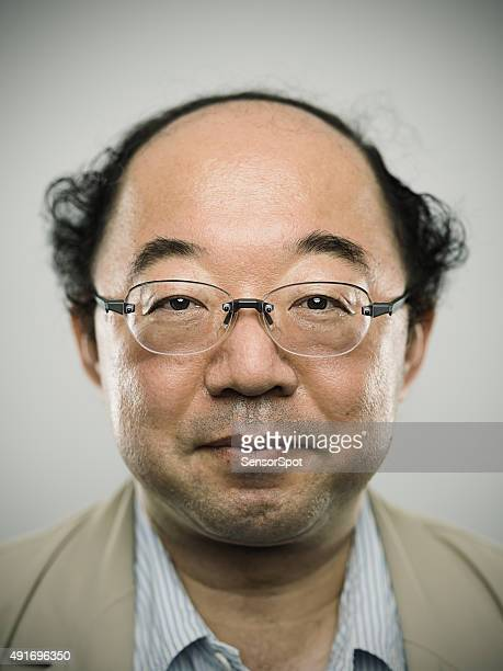 Portrait of a real japanese man with black hair.