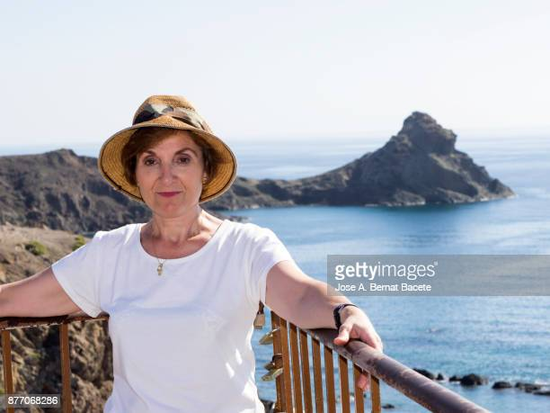 portrait of a real pople woman, looking at the camera on the coast of the beach. - iberian stock photos and pictures