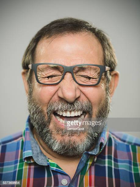 portrait of a real spanish man with glasses and beard. - extatisch stockfoto's en -beelden