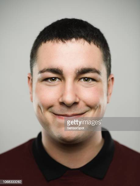 portrait of a real young caucassian man smiling at camera. - part of a series stock pictures, royalty-free photos & images