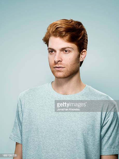 Portrait of a red hair male looking away