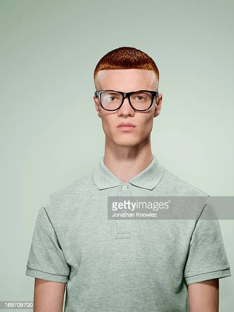 portrait of a red hair male with glasses on - ebete foto e immagini stock