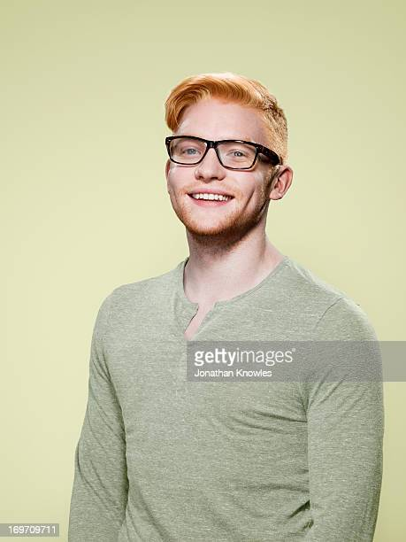 Portrait of a red hair male with glasses smiling
