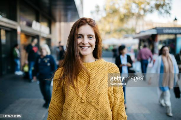 portrait of a red-haired woman in the city - incidental people stock pictures, royalty-free photos & images