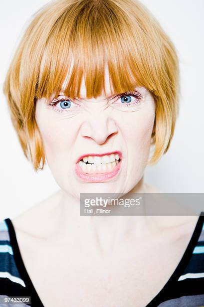 Portrait of a red-haired woman making a grimace.