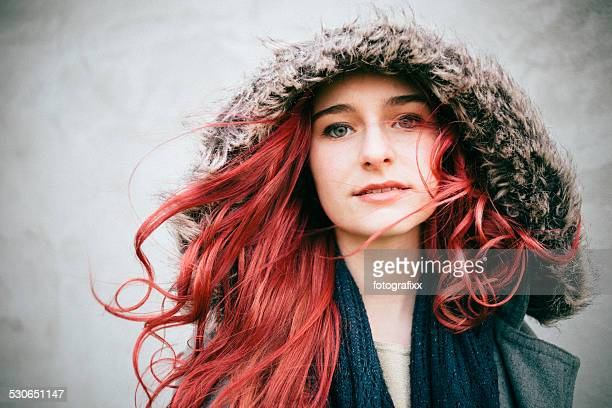 portrait of a redhead teenager girl, looking at camera - dyed red hair stock pictures, royalty-free photos & images