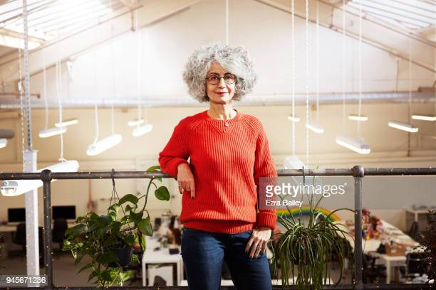 Portrait of a relaxed woman working in an industrial office space.