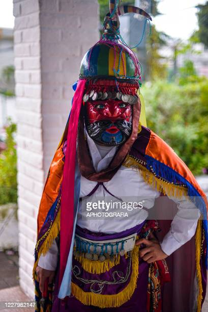 Portrait of a reveler member of Los Historiantes traditional dance dating to the Spanish conquest as part of international Indigenous day amid...
