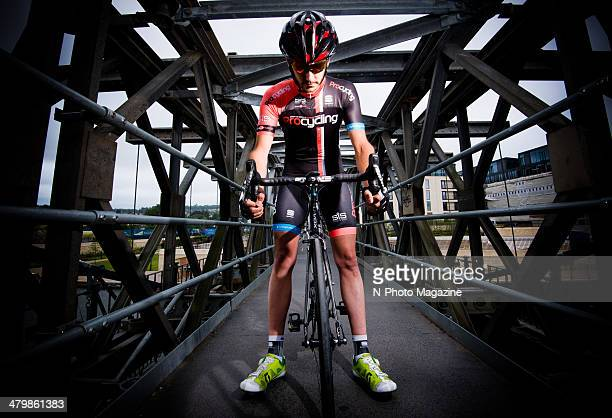 Portrait of a road cyclist posing with a Swift Carbon Ultravox Ti bicycle on Midland Bridge in Bath England taken on July 4 2013