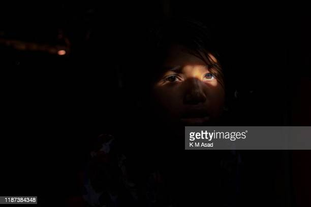 HAKIMPARA UKHIYA BANGLADESH Portrait of a Rohingya girl siting in her makeshift tent at Hakimpara Rohingya camp in Ukhiya The refugees are eyeing for...