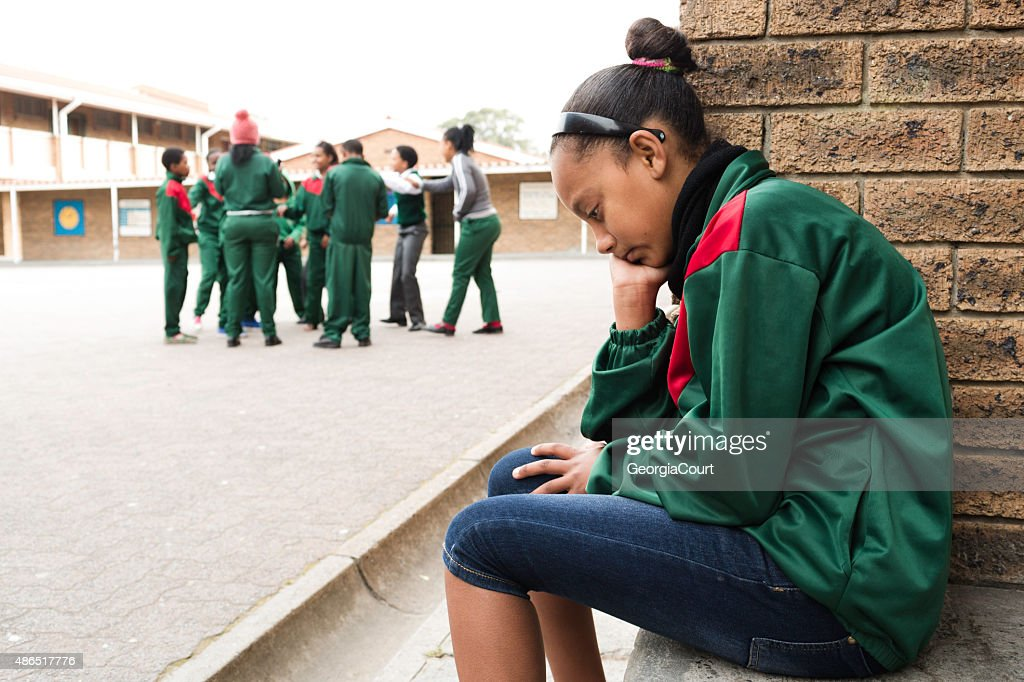 Portrait of a sad schoolgirl : Stock Photo