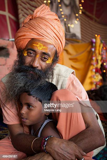 CONTENT] Portrait of a Sadhu holding a child in his arms inside the Juna akhara during Maha Kumbh Mela held in april 2010 Juna Akhara Haridwar...