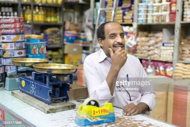 Portrait of a salesman in a grocery store in the old town of Asmara in Eritrea on August 23 2018 in Asmara Eritrea