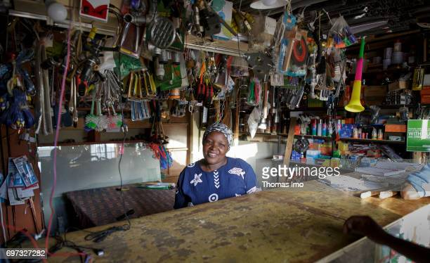 Portrait of a saleswoman in her shop for household goods on May 17 2017 in Talek Kenya