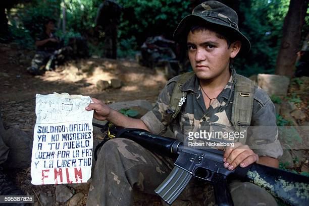 Portrait of a Salvadoran soldier who holds up a flyer printed by oppositional Farabundo Marti National Liberation Front guerrillas in the San Miguel...