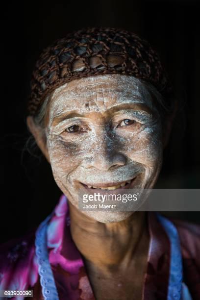 Portrait of a Sama-Bajau woman wearing natural sunblock.