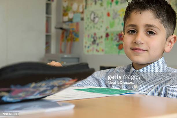 Portrait of a school boy taking exam in classroom, Munich, Bavaria, Germany