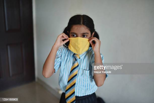 portrait of a school girl wearing face mask - india stock pictures, royalty-free photos & images