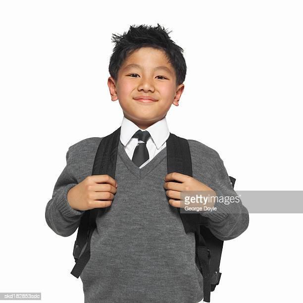 portrait of a schoolboy (8-9) wearing his school uniform