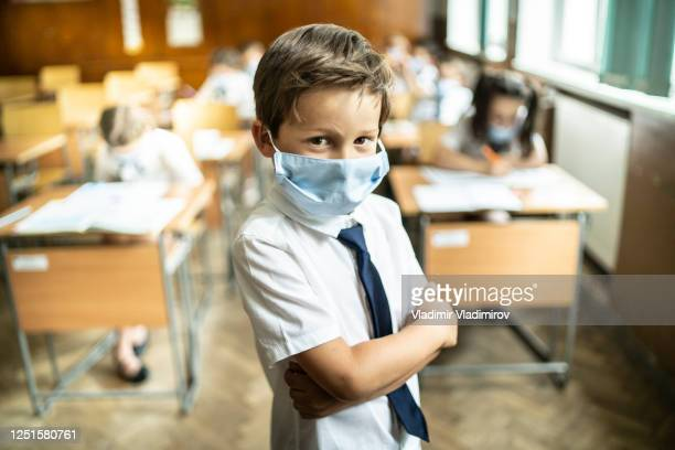 covid-19. portrait of a schoolboy wearing protective mask. - reopening stock pictures, royalty-free photos & images