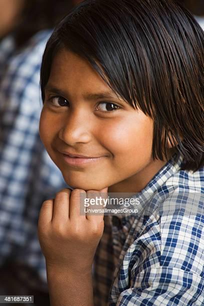 Portrait of a schoolgirl smirking