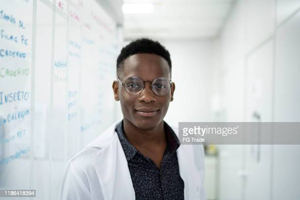 portrait of a scientist at laboratory - scientist stock pictures, royalty-free photos & images