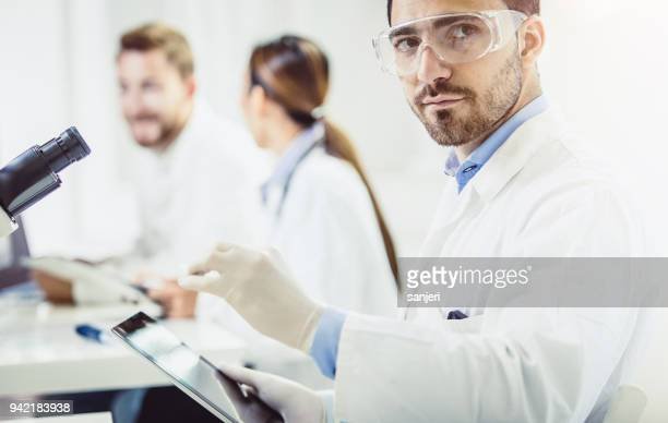 Portrait of a Scientist Holding a Microscope Slide