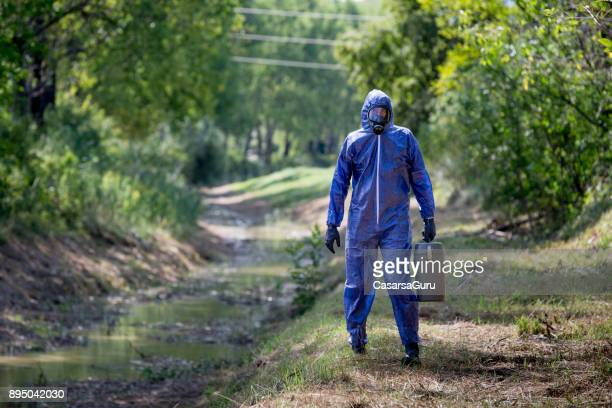 Portrait of a Scientist in Protective Workwear Standing on Creekbank