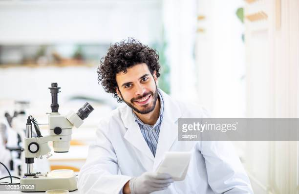 portrait of a scientist in the laboratory - microbiologist stock pictures, royalty-free photos & images