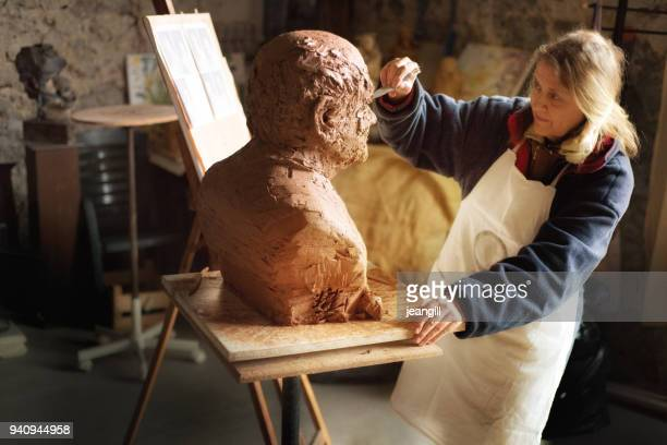 portrait of a sculptor in her workshop, provence - sculptor stock pictures, royalty-free photos & images
