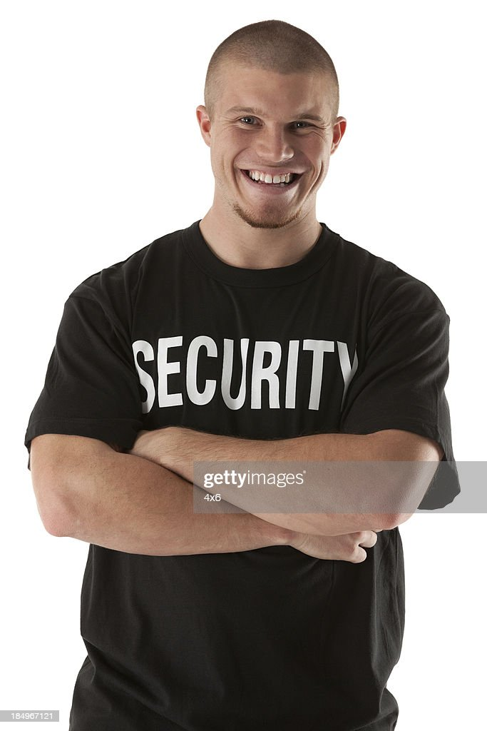 Portrait of a security guard smiling : Stock Photo