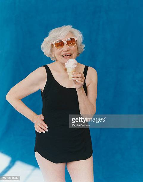 Portrait of a Senior Adult Holding an Ice Cream With Her Hand on Her Hip