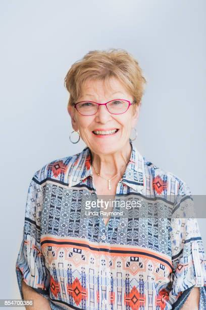 portrait of a senior adult woman - blouse stock pictures, royalty-free photos & images
