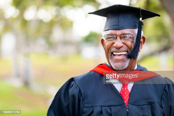 portrait of a senior african american graduate - graduation clothing stock pictures, royalty-free photos & images
