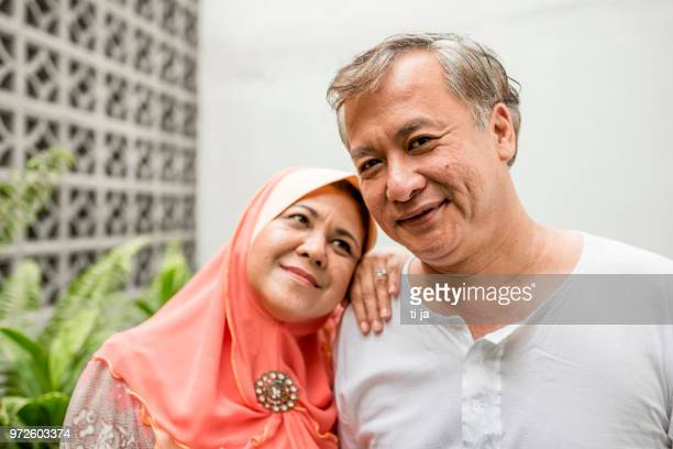 portrait of a senior asian couple - muslim couple stock pictures, royalty-free photos & images