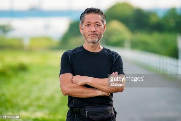 Portrait of a senior asian runner
