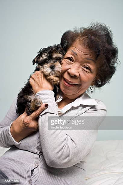 Portrait of a Senior Asian Woman and Pet puppy