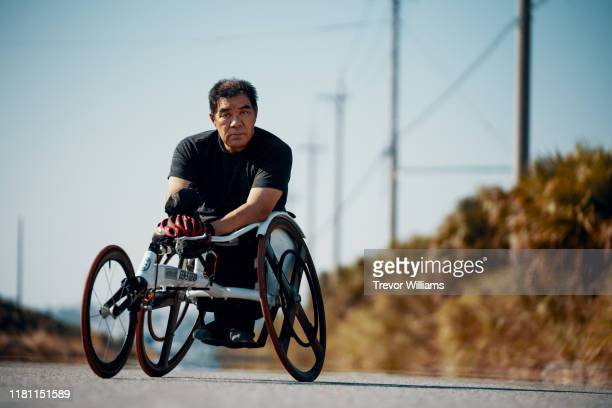 portrait of a senior athlete in a racing wheelchair. - differing abilities fotografías e imágenes de stock
