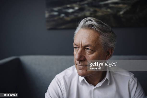 portrait of a senior businessman - introspection stock pictures, royalty-free photos & images
