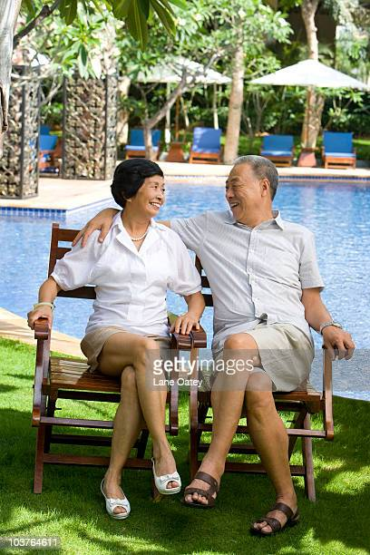 Portrait of a senior couple by the pool