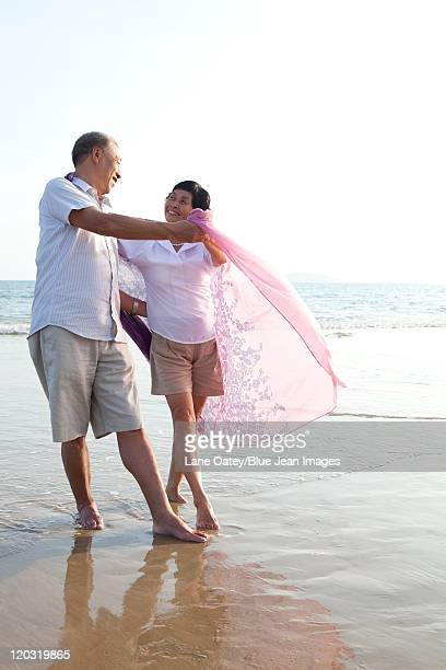 Portrait of a senior couple dancing on the beach